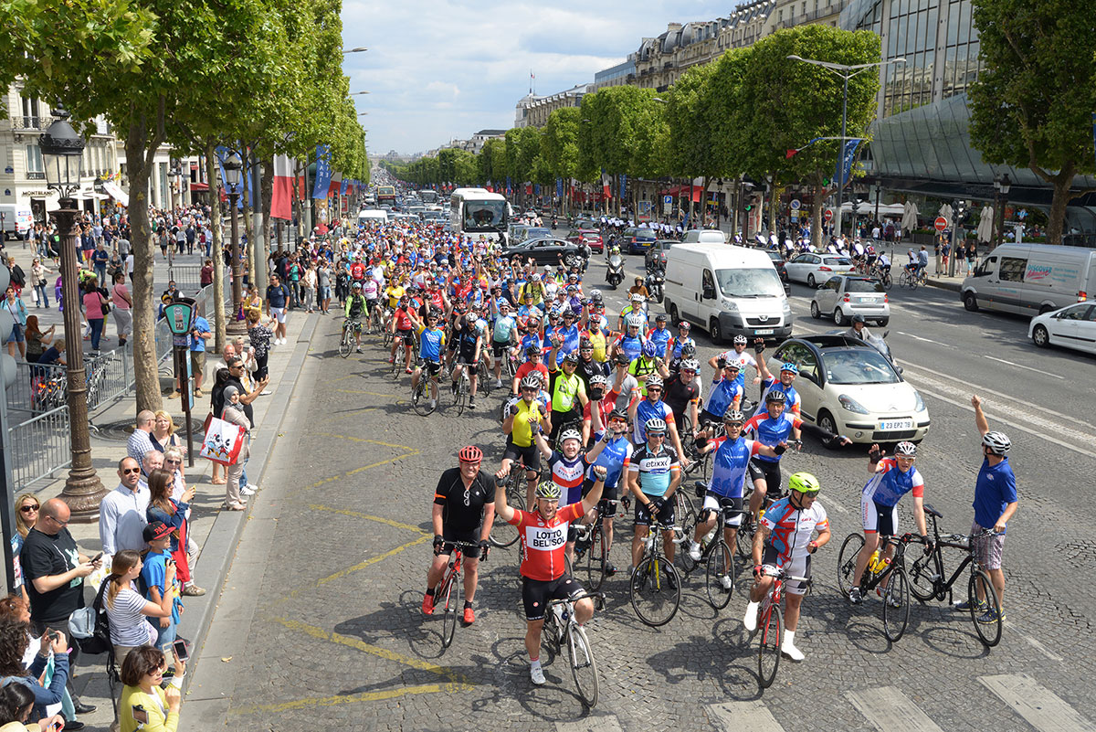 Cyclists riding through Paris